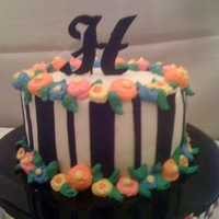 Mary Engelbreitish Cake! Inspired by another baker on CC! Buttercream except for fondant black stripes and initial. Fun (and quick!) cake. Just happened to have the...