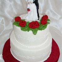 Red Roses And Stenciling Small wedding cake with white RI stenciling on the side and red RI roses on top. Topper provided by the bride.