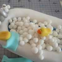 Rubber Duckie   rice krispie with fondant details and luster dust