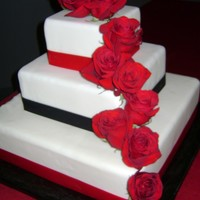 Red And Black Wedding Cake! All MMF. Satin ribbon and fresh flowers.