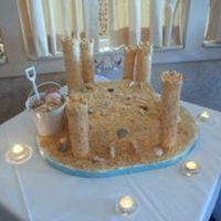 Sandcastle Wedding Cake A wedding cake for my brother in Saint Augustine FL. Yellow Amaretto Cake, Raspberry Cream Filling with BC icing. Sand is 3 boxes of Nilla...