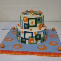 Retro Geometric Design Baby Shower Cake Cake is for a baby shower. Heat and humidity was an issue. Buttercream with fondant geometric shapes & gumball decorations, Darn Good...