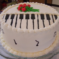 Piano Recital White cake iced with vanilla butter cream. Piano keys and roses are fondant.