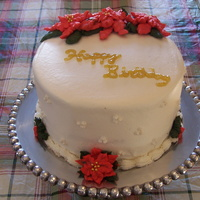 Christmas Birthday White cake with vanilla butter cream icing. Everything is butter cream except for the edible pearls on the side and the glitter gel. I will...