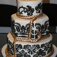 Ivory Black And Gold Rope   Elegant Cake with Gold ropes for a little extra pop