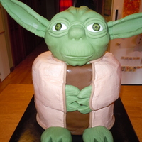"3D Standing Yoda! Here he is . . . the birthday boy asked for a root beer flavored standing 3D Yoda cake. He ended up being about 15"" tall. His body is..."