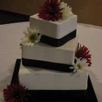 Square Tiers With Ribbons And Flowers