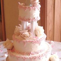 Buttercream Petals This is a buttercream, edible pearls, and the borders are buttercream petals in pink.