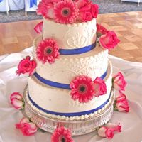 Royal And Gerberas Piping meant to look like the brides dress;