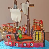 Captain Hook's Ship This was a cake my husband designed for a Peter Pan themed party. It is his baby....all I did was bake and make fondant. Both of the...
