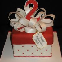 Red And White Anniversary Cake Square fondant covered cake with fondant loop bow. I made the 2 out of 50/50 paste and thenpiped dots on top. Gift tag also made out of...