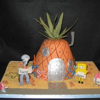 "Spongebob Square Pants & Friends The famous ""pineapple under the sea"" with it's resident and friends. Pineapple is cake and figurines are made out of..."