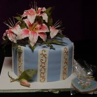 Mother's Day Cake W/ Day Lilies Lilies made of gumpaste. Cookie matches cake. TFL!