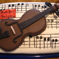 Violin Cake  This cake was made for a going away recital for my daughter's violin teacher. The violin is carved from cake, then covered in fondant...