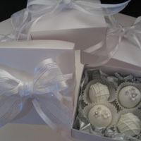 Bridal Shower Favors Brownie Truffles  Brownies dipped in white candy melts. The tiny flowers are made from Pettinice fondant, dusted with silver and a dragee in centers. My...