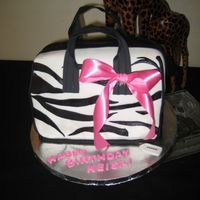 "Our Version Of A New Line Of Coach Bags...animal Print! The b-day girl works for Coach; however, her b-day party was going to be held at a hotel called ""Sheraton Safari Resort"" and the..."
