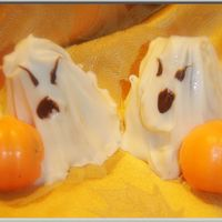 Halloween Ghost And Pumpkin Cake Balls Devils Food cake crumbled, mixed with bc frosting and a bit of raspberry preserves. Shaped into blobs for Ghosts and coated with melted...