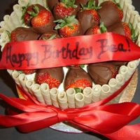 "Chocolate Covered Strawberries With Piroutte Wafers  Birthday cake for a 58 year old. They wanted something elegant, the second one of these I have made. 8"" Vanilla with BC icing (cake..."