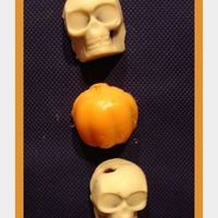 Halloween Skulls And Pumpkin Cake Balls  Devils food cake crumbled with bc icing and raspb. preserves. Formed both in silicone molds (made for ice cubes). White Chocolate melted...