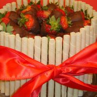 "Pirouette Cake With Chocolate Covered Strawberries Quick cake for a Lobster Boil. 8"" WASC - Chocolate Cake, fresh strawberries in buttercream filling, chocolate fudge frosting...."