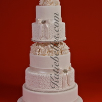 Winter Romance white wedding cake, lace, sugar flowers, rhinestones, bows, berries