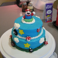 Blake's 6Th Birthday   2nd year in a row my son has picked Mario. WASC with buttercream and fondant characters. TFL