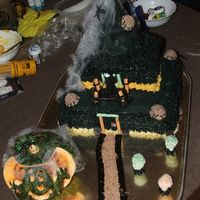 Witchs Hat  This cake was awesome! the pictures do not do it justice at all it was made of 3 cakes covered in BC (black orange and cream) there was...