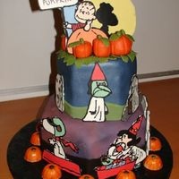 Great Pumpkin Charlie Brown! Fondant covered chocolate ganache cake. Characters done with choclate transfers. Marzipan pumpkins and leaves. Thanks to alleypoo9782 for...