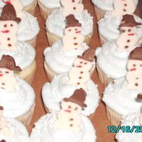 Flurry Of Snowmen Mini-cupcakes with candy melt snowmen for my son's pre-k party. These were so easy and fun to make.
