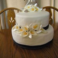 25Th Anniversary Cake Cake didnt' work out so well, but the flowers did. The cake is a butter pecan cake, that fell apart. It was supposed to be covered...