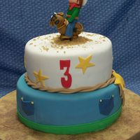 Cowboy Birthday Cake This cake was done for my sons 3rd birthday. We had a party at a petting zoo/ranch. He is very much into being a cowboy and wearing his...