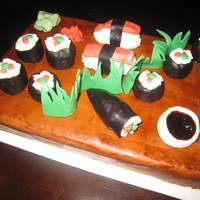 Sushi Anyone? i used rkt inside my sushi rolls. the rest is fondant. the soy sauce is tinted piping gel.