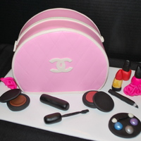 "So Pretty Used fondant to make the accessories. The makeup bag is 2-8"" rounds with the bottom cut off."