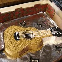 Guitar Cake   This is one of my first cakes. My nephew loved it so that's what was important. The notes are MMF and the plaque is chocolate. TFL!