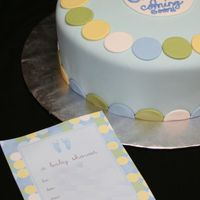 "Polka Dot Cake 10"" cake decorated to match invitations. Three layers WASC, bavarian cream filling. Buttercream frosting, vanilla fondant."
