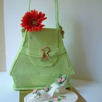 Fancy Shopping !!! All edible, purse made of fondant, shoe and flower made of gumpaste.