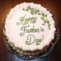 Happy Father's Day Triple-layer, white almond cake filled with Bavarian Cream. Vanilla/Creme Bouquet buttercream frosting. 9 inch round. It was a dessert cake...