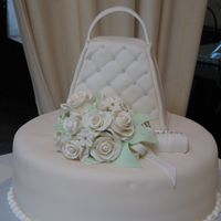 Bridal Shower Cake Bridal shower cake with fondant covered purse and gumpaste bouquet of flowers.