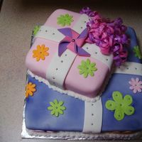 Girls Flowery Cake This is my first time using fondant to cover a cake. Actually it's my first time ever making a cake like this. I had a good time...