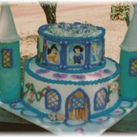 Princess Castle Birthday Cake covered in buttercream...decorations in fondant and princess pictures were laminated...really enjoy doing these!