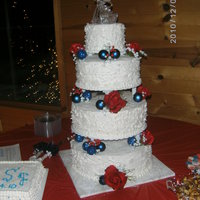 Sister's Christmas Wedding  4 tiers...double layered...cho, butter recipe, fun fetti flavors...sugar shack buttercream. Did spackling on sides before frosting crusted...
