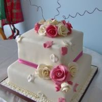 Romantic Wedding Two tier ivory cake with diamante studded handmade sugar roses.