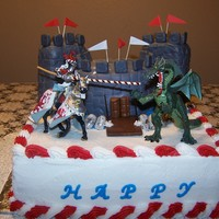 Dungeons And Dragons 12' square and 6' round vanilla with raspberry filling covered in bc. Made for twin 13 year old boy's birthday. They are...