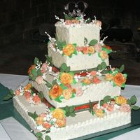 Dscf0312.jpg This was my first wedding cake i made for my own wedding. Flowers are hand made
