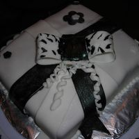 My First Decorated Cake Black and white present with a bow. It was made out of fondant.