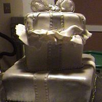 Silver & Ivory Gift Boxes I like this cake, but the color was to pale for me. The bow still has the tissues TFL.