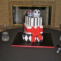 Day Of The Dead Wedding Bride did not want anything traditional. Designed a cake around her day of the dead topper. The topper was too big in my opinion but she...