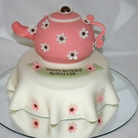 Tea Time! Vanilla cake covered in MMF. Spout, handle, and flowers all gum Paste. Tea Pot made from baking cake in 2 round bowls and then put together...