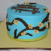 The Jaleigh Cake Chocolate cake covered in BC. Flowers and branch GP