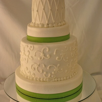 Bridal Shower 4 tier buttercream with lime green ribbon. I loved this cake because of the different heights of each tier. It makes is so much more...